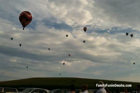 A large group of hot air balloons at Ditmars Orchard Hot Air Balloon Festival