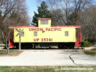 A yellow train caboose with the words Union Pacific.
