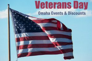 A close up of a flag with overlay text that reads Veterans Day Omaha Events and Discounts