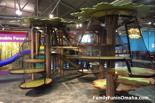 A close up of tree-shaped climbing sets at the Omaha Children\'s Museum.