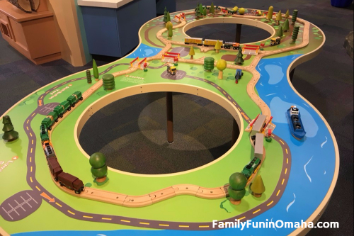 A toy trainset and train table in Forever Forest at the Omaha Children\'s Museum.