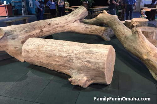 A close up of large artificial tree logs at the Omaha Children\'s Museum.