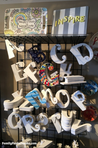 A display of unpainted letters at It\'s Yours Pottery.