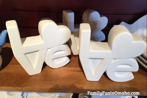 A love figurine ready to paint at It\'s Yours Pottery.