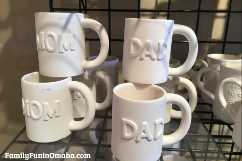 Mom and dad mugs to paint at It\'s Yours Pottery.