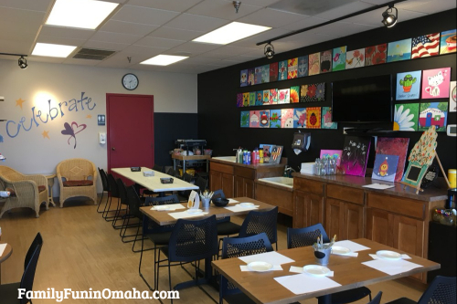 A prepared group of tables for a painting class at It\'s Yours Pottery.