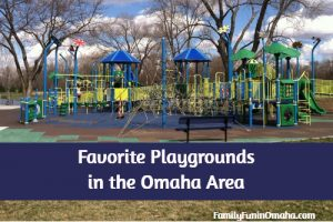 A large blue and yellow children\'s playground with overlay text that reads Favorite Playgrounds in the Omaha Area