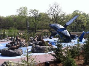A park with seal and whale sculptures at Alaskan Adventure Splashground.