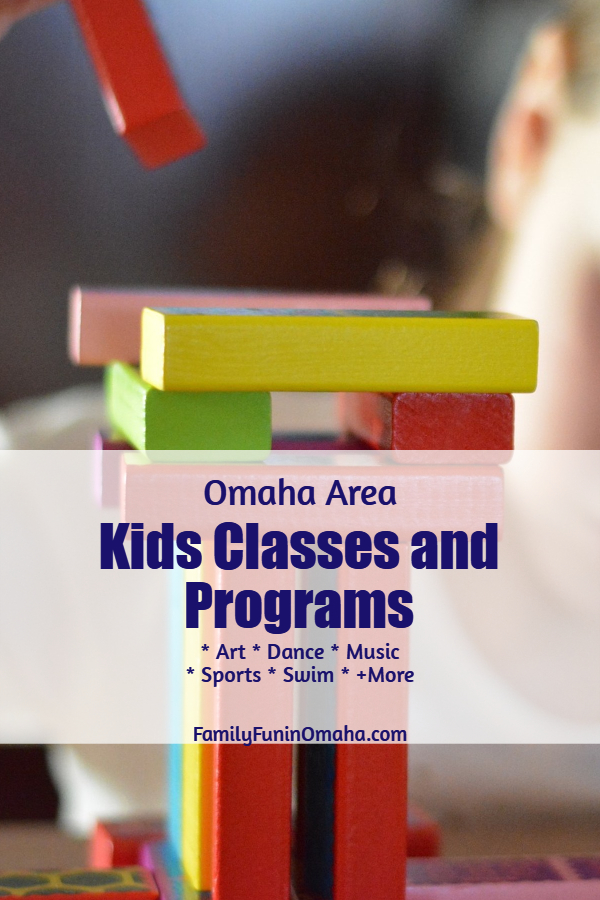 A close up of children\'s building blocks with overlay text that reads, Omaha Areas Kids Classes and Programs.