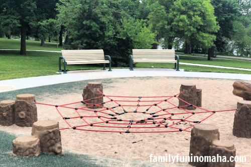 A web climbing feature at Standing Bear Lake Playground