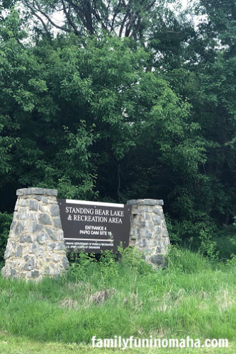 A close up of the entrance sign at Standing Bear Lake and Recreation Area.