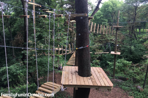A wooden platform in an obstacle course at Tree Rush Adventures.