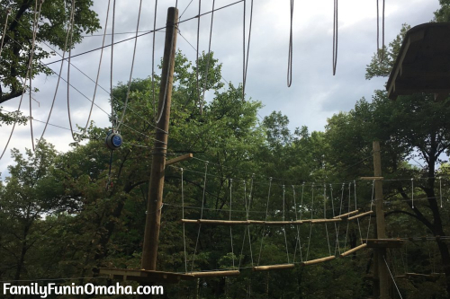A narrow plank walking feature at Tree Rush Adventures.