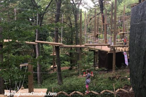 A girl climbing at Tree Rush Adventures.