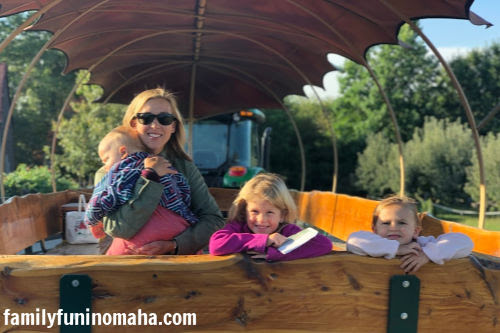 A family on a waggon ride at Arbor Day Farm.