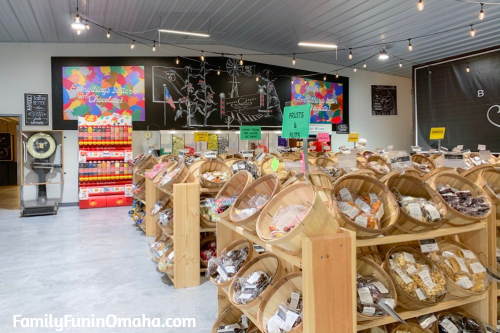 A store filled with baskets of candy on display at Baker\'s Candies.