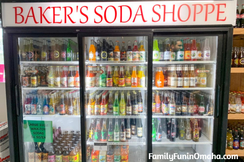 A refrigerator in a store filled with beverages at Baker\'s Candies.
