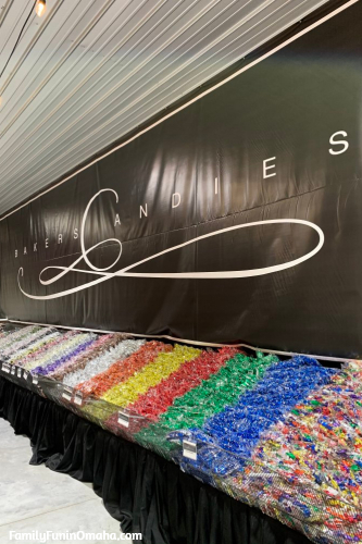 A large candy display on against a wall with a sign that reads Baker\'s Candies.