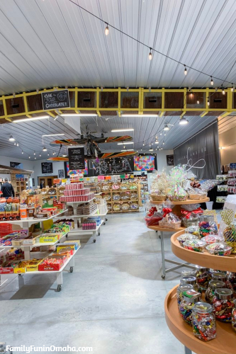 A store filled with candy displays at Baker\'s Candies.