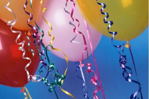 A close up of party balloons on a blue background.