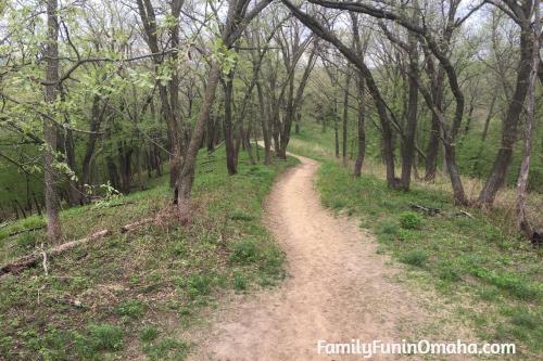 A long dirt walking path at Hitchcock Nature Center.