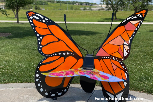 A large orange butterfly bench in Papillion.
