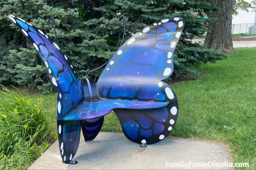 A large blue and white butterfly bench in Papillion.