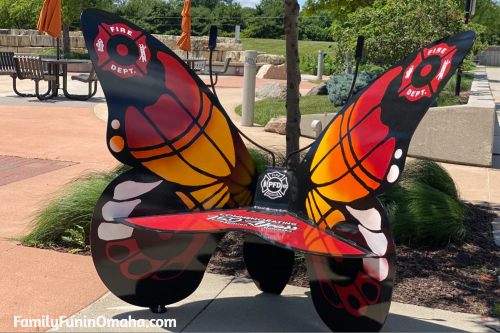A large colorful butterfly bench in Papillion.