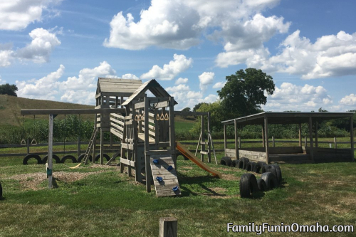 A large wooden playground at Ditmars Orchard