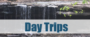A close up of a waterfall with overlay text that reads, Day Trips.