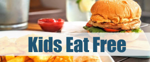A table of food with overlay text that reads, Kids Eat Free.